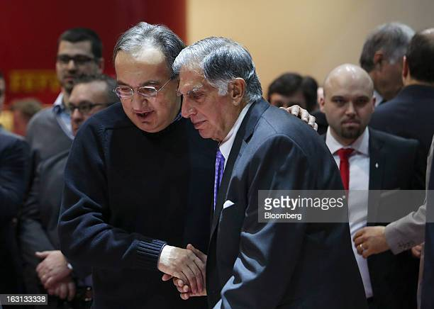 Sergio Marchionne chief executive officer of Fiat SpA and Chrysler Group LLC center left with Ratan Tata chairman of Tata Motors Ltd center right...