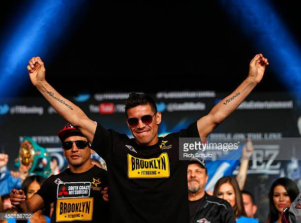 Sergio Martinez raises his arms before being weighed in on June 6 2014 in New York City Martinez will be fighting Miguel Cotto for the WBC...