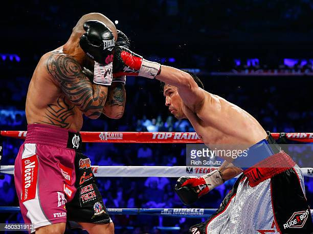 Sergio Martinez right of Argentina lands a left Miguel Cotto of Puerto Rico during the fourth round as they battle for the WBC Middleweight...