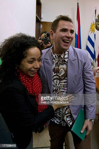 Sergio Miranda pose with friend Julissa Reynoso the US ambassador to Uruguay after getting married with partner Rodrigo Borda at the civil registry...