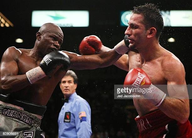 Sergio Mora and Vernon Forrest trade blows during their WBC super welterweight title fight at the MGM Grand Garden Arena September 13, 2008 in Las...