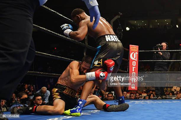 Sergio Mora crumples to the ground while holding onto Daniel Jacobs during the WBA Middleweight Championship on September 9, 2016 in Reading,...