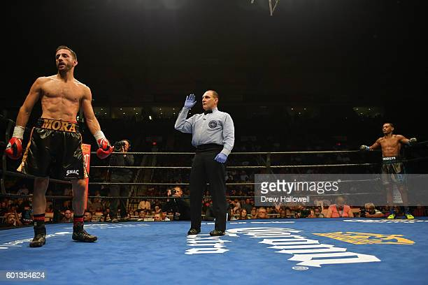Sergio Mora gets a standing count as Daniel Jacobs looks on during the WBA Middleweight Championship on September 9, 2016 in Reading, Pennsylvania.