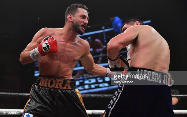 Sergio Mora throws a left at Alfredo Angulo during their super middleweight bout at The Joint inside the Hard Rock Hotel & Casino on April 7, 2018 in...