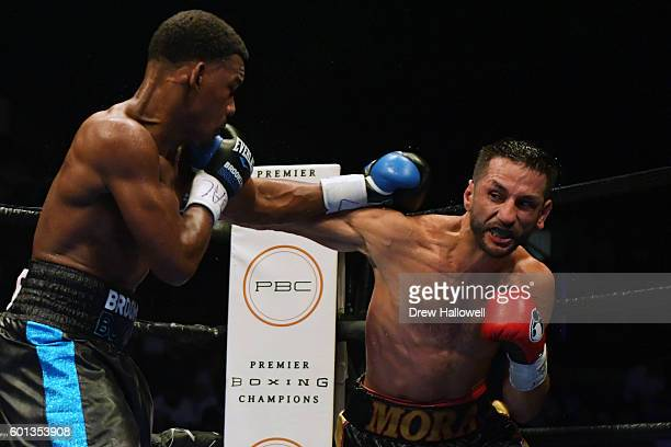Sergio Mora throws a punch at Daniel Jacobs during the WBA Middleweight Championship on September 9, 2016 in Reading, Pennsylvania.