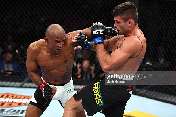 Sergio Moraes of Brazil punches Luan Chagas of Brazil in their welterweight bout during the UFC 198 event at Arena da Baixada stadium on May 14, 2016...