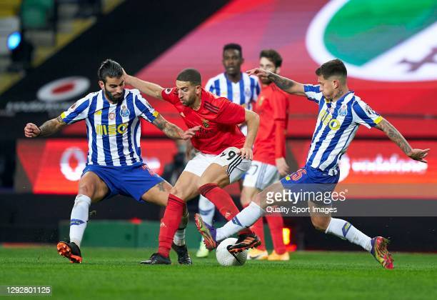 Sergio Oliveira of FC Porto and Otavio Edmilson da Silva of FC Porto competes for the ball with Adel Taararbt of SL Benfica during the Portuguese...