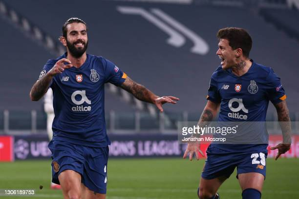 Sergio Oliveira of FC Porto celebrates after scoring a first half penalty to give the side a 1-0 lead during the UEFA Champions League Round of 16...