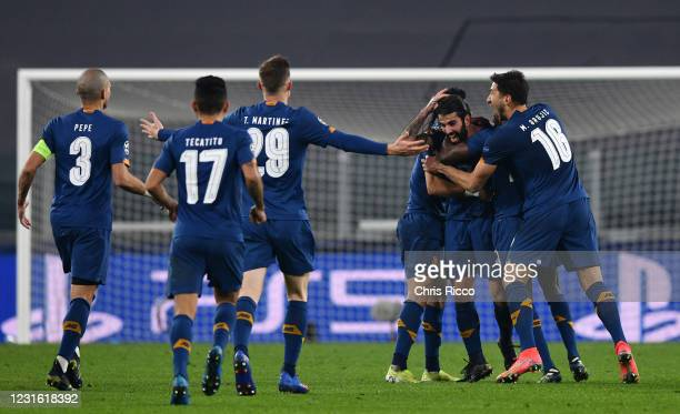 Sergio Oliveira of FC Porto celebrates goal with teammates during the UEFA Champions League Round of 16 match between Juventus and FC Porto at...