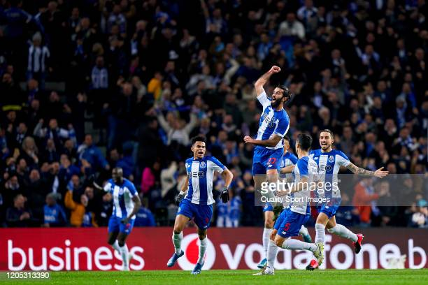 Sergio Oliveira of FC Porto celebrates with his team mates after scoring his team's first goal during the Liga Nos match between FC Porto and SL...