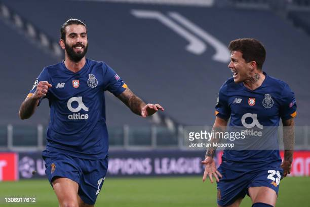 Sergio Oliveira of FC Porto celebrates with team mate Otavio after scoring a first half penalty to give the side a 1-0 lead during the UEFA Champions...