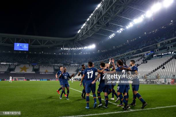 Sergio Oliveira of FC Porto celebrates with team mates after scoring a first half penalty to give the side a 1-0 lead during the UEFA Champions...