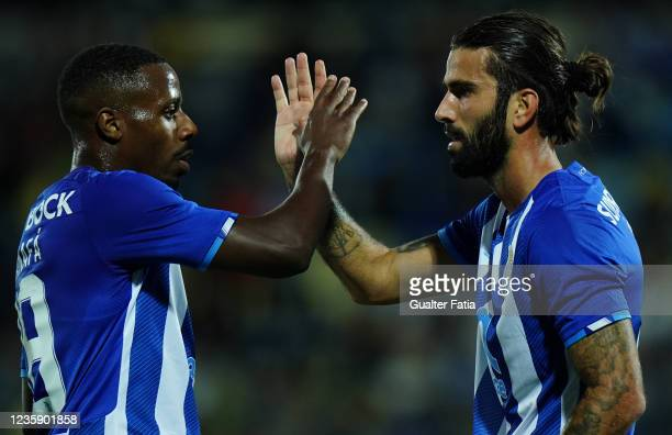 Sergio Oliveira of FC Porto celebrates with teammate Wilson Manafa of FC Porto after scoring a goal during the Portuguese Cup match between SU...