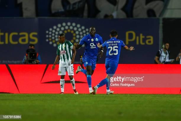 Sergio Oliveira of FC Porto celebrates with teammates after scoring a goal during the Liga NOS match between Vitoria FC and FC Porto at Estadio do...