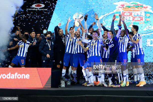 Sergio Oliveira of FC Porto lifts the Candido de Oliveira trophy with teammates following victory in the Portuguese Super Cup final between FC Porto...