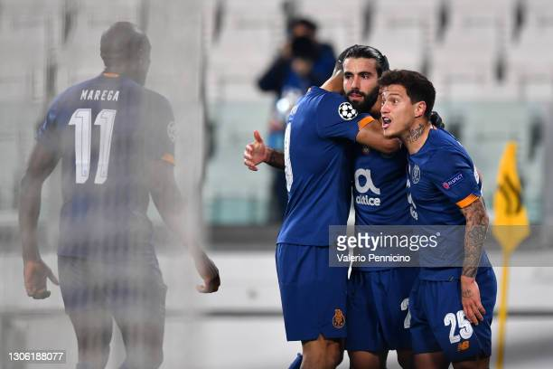 Sergio Oliveira of Porto celebrates with Mehdi Taremi and Otavio after scoring their side's first goal from the penalty spot during the UEFA...