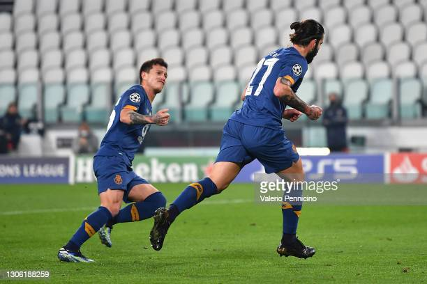 Sergio Oliveira of Porto celebrates with Otavio after scoring their side's first goal from the penalty spot during the UEFA Champions League Round of...