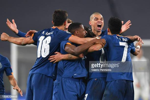 Sergio Oliveira of Porto celebrates with team mates after scoring their side's second goal during the UEFA Champions League Round of 16 match between...