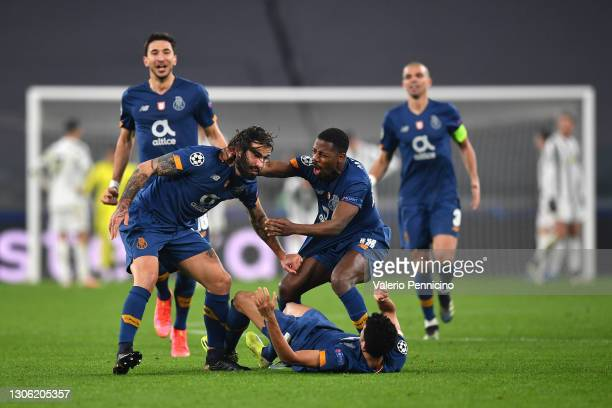 Sergio Oliveira of Porto celebrates with Wilson Manafa and Luis Diaz after scoring their side's second goal during the UEFA Champions League Round of...
