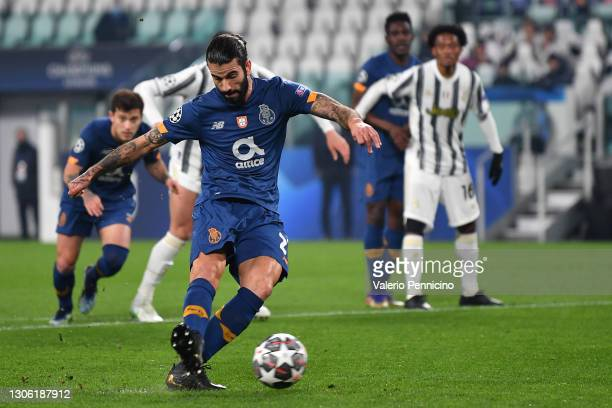 Sergio Oliveira of Porto scores their side's first goal from the penalty spot during the UEFA Champions League Round of 16 match between Juventus and...