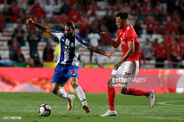 Sergio Oliveira of Porto vies for the ball with Andreas Samaris of Benfica during the Portuguese League football match between SL Benfica and FC...