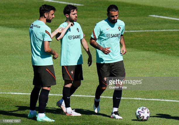 Sergio Oliveira of Portugal and FC Porto with Bernardo Silva of Portugal and Manchester City and Bruno Fernandes of Portugal and Manchester United in...