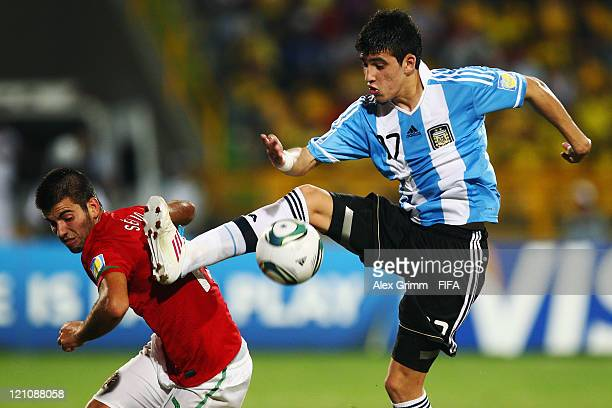 Sergio Oliveira of Portugal is challenged by Rodrigo Battaglia of Argentina during the FIFA U20 World Cup 2011 quarter final match between Portugal...