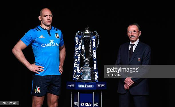 Sergio Parisse captain of Italy and head coach Jacques Brunel pose with the trophy during the RBS Six Nations launch at The Hurlingham Club on...