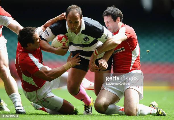 Sergio Parisse of Barbarians is tackled by Gavin Henson and Stephen Jones of Wales during the International Match between Wales and Barbarians at...