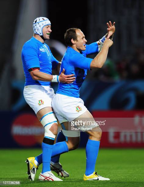 Sergio Parisse of Italy celebrates with teammate Cornelius van Zyl after he scores their first try during the IRB 2011 Rugby World Cup Pool C match...