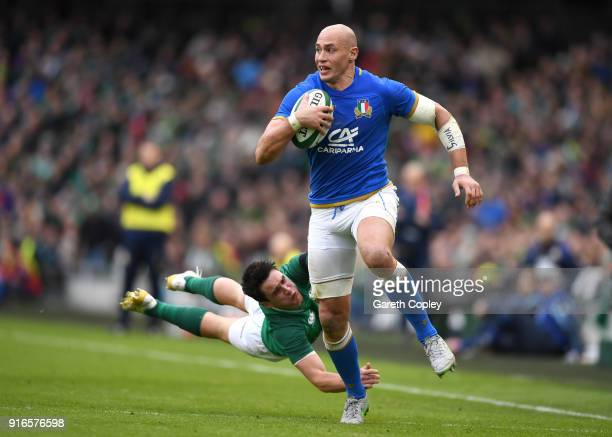 Sergio Parisse of Italy escapes the tackle of Joey Carbery of Ireland during the NatWest Six Nations match between Ireland and Italy at Aviva Stadium...