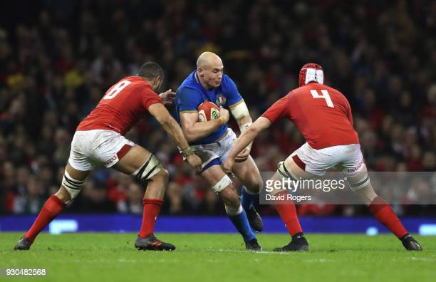Sergio Parisse of Italy is tackled by Cory Hill and Taulupe Faletau of Wales during the NatWest Six Nations match between Wales and Italy at...