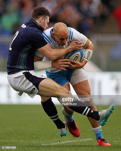 Sergio Parisse of Italy is tackled by Duncan Taylor of Scotland during the RBS Six Nations match between Italy and Scotland at Stadio Olimpico on...