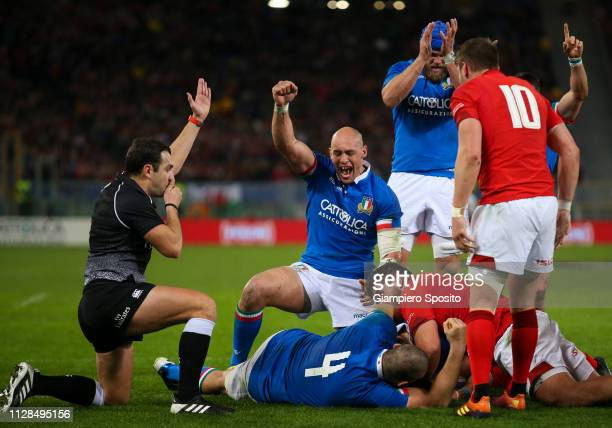 Sergio Parisse of Italy reacts as he teammate Abraham Steyn scores a try during the Guinness Six Nations match between Italy and Wales at Stadio...