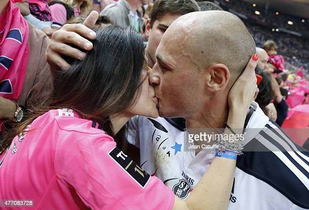 Sergio Parisse of Stade Francais and his wife Silvia Bragazzi celebrate winning the 'bouclier de Brennus' Trophy after the Top 14 Final between ASM...