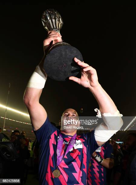 Sergio Parisse of Stade Francais celebrates with the trophy following his team's 2517 victory during the European Rugby Challenge Cup Final between...