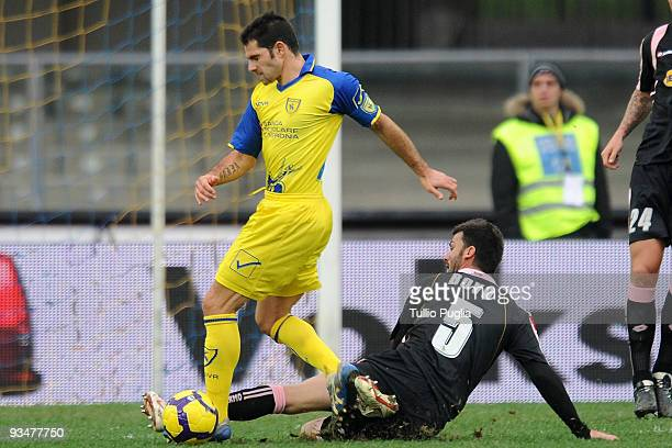 Sergio Pellissier of Chievo and Cesare Bovo of Palermo compete for the ball during the Serie A match between AC Chievo Verona and US Citta di Palermo...