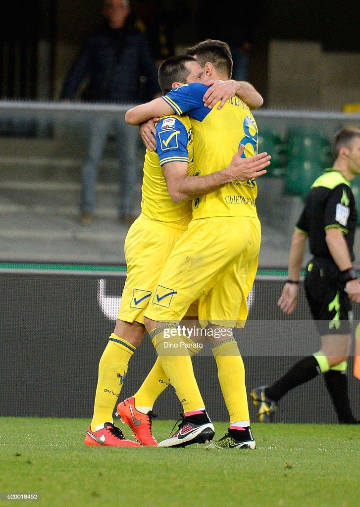 Sergio Pellissier (L) of Chievo Verona celebrates after scoring his opening goal during the Serie A match between AC Chievo Verona and Carpi FC at Stadio Marc'Antonio Bentegodi on April 9, 2016 in Verona, Italy.