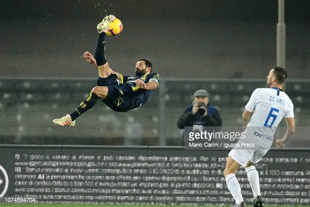 Sergio Pellissier of Chievo Verona kicks the ball towards the goal in the air during the Serie A match between Chievo Verona and FC Internazionale at...