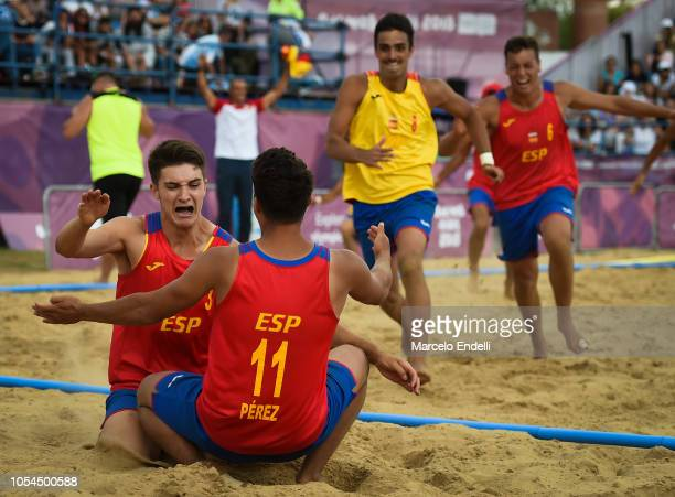 Sergio Perez Manzanares of Spain celebrates with teammates after winning the Men Gold Medal Match against Portugal during day 7 of Buenos Aires 2018...