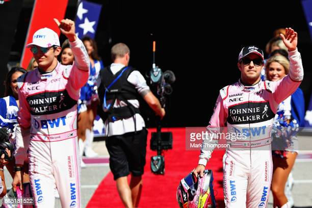 Sergio Perez of Mexico and Force India and Esteban Ocon of France and Force India walk to the grid before the United States Formula One Grand Prix at...