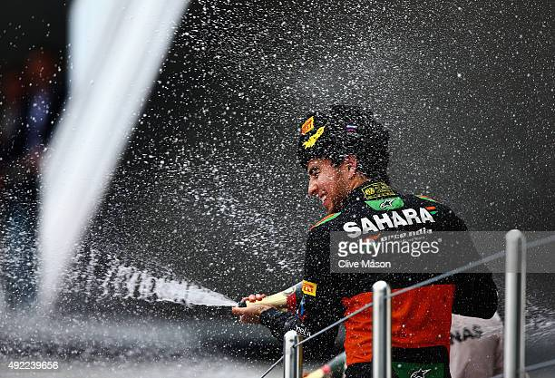 Sergio Perez of Mexico and Force India celebrates on the podium after finishing third in the Formula One Grand Prix of Russia at Sochi Autodrom on...