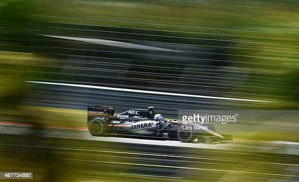 Sergio Perez of Mexico and Force India drives during practice for the Malaysia Formula One Grand Prix at Sepang Circuit on March 27 2015 in Kuala...