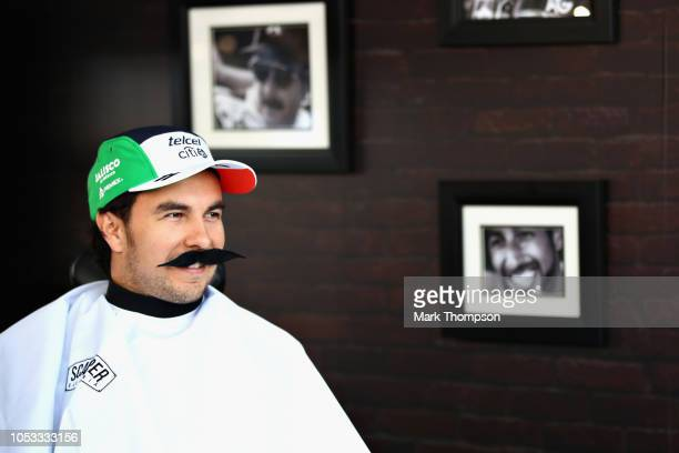 Sergio Perez of Mexico and Force India gets a haircut in the paddock barbers during previews ahead of the Formula One Grand Prix of Mexico at...