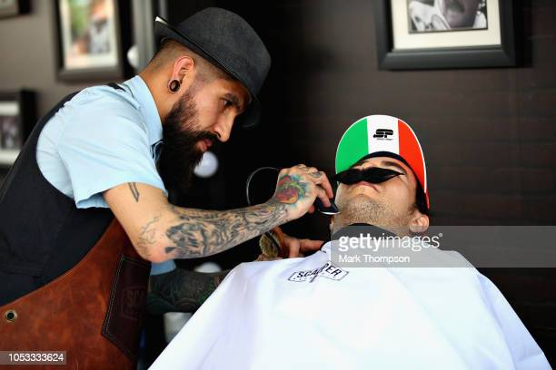 Sergio Perez of Mexico and Force India gets a shave in the paddock barbers during previews ahead of the Formula One Grand Prix of Mexico at Autodromo...
