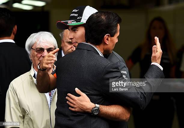 Sergio Perez of Mexico and Force India greets the President of Mexico Enrique Pena Nieto next to F1 supremo Bernie Ecclestone outside the Force India...