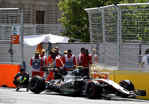 Sergio Perez of Mexico and Force India looks at his car after crashing at the end of final practice before the European Formula One Grand Prix at...