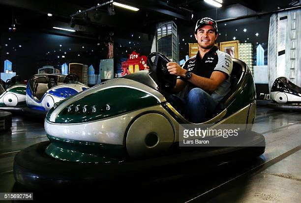 Sergio Perez of Mexico and Force India poses for a photo on the dodgems during previews to the Australian Formula One Grand Prix at Albert Park on...