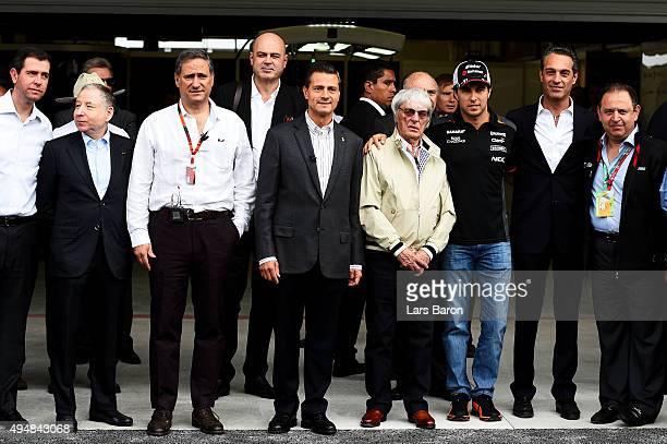 Sergio Perez of Mexico and Force India poses with the President of Mexico Enrique Pena Nieto F1 supremo Bernie Ecclestone and President of the FIA...