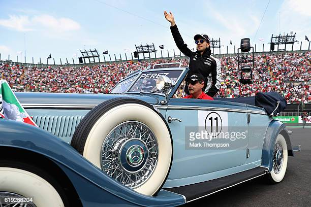Sergio Perez of Mexico and Force India waves to the crowd on the drivers parade before the Formula One Grand Prix of Mexico at Autodromo Hermanos...
